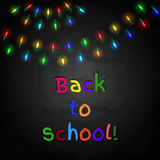Chalkboard background with bulb lights. Back to school Royalty Free Stock Photo