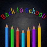 Chalkboard background with colorful pencils. Back to school Stock Images