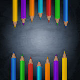 Chalkboard background with colorful pencils Royalty Free Stock Photos
