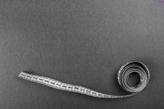 Chalkboard background with measuring tape White measuring tape royalty free stock photos