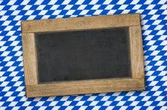 Chalkboard on a bavarian diamond pattern Stock Photos