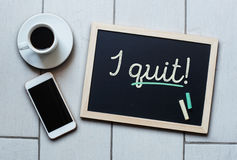 Chalkboard or Blackboard concept saying - I QUIT!. With coffee and mobile phone. Quit Job Motivation Aspiration Concept stock images