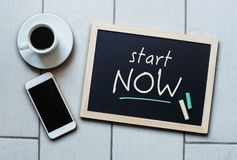 Chalkboard or Blackboard concept saying START NOW Royalty Free Stock Photography