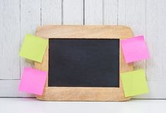 Chalkboard and blank sticky note, post note or post-it on Office Stock Photography