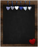 Chalkboard Blue and Red Gingham Love Valentine's hearts hanging. Chalkboard Blue Gingham Love Valentine's heart hanging on wooden frame with blackboard, Red Stock Images