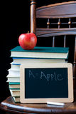 Chalkboard and books Stock Photos