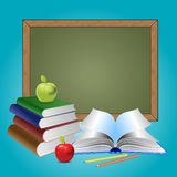 Chalkboard and books Royalty Free Stock Image