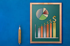 Chalkboard with business icon and money paper cut Stock Photography