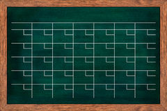 Chalkboard calendar for home or office organization. Royalty Free Stock Photos