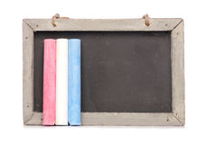 Chalkboard and chalk Stock Images