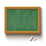 Chalkboard and chalks Stock Photo