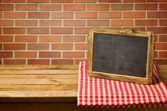 Chalkboard on checked tablecloth. Copy space for your text or message display Stock Photography