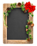 Chalkboard with christmas decoration and red ribbon bow Royalty Free Stock Images