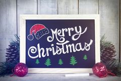 Chalkboard with christmas decoration on a wooden background and Stock Photo