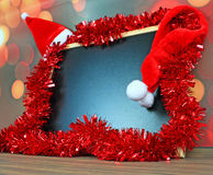 Chalkboard and christmas decorations Stock Photo