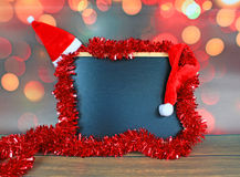 Chalkboard and christmas decorations Stock Image
