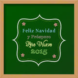 Chalkboard with christmas greeting in spanish Royalty Free Stock Image