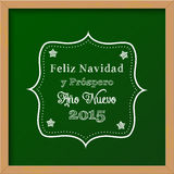 Chalkboard with christmas greeting in spanish Stock Image