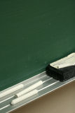 Chalkboard Closeup. Chalk and an eraser ready to be used for learning Royalty Free Stock Images