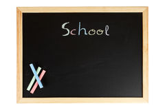 Chalkboard with colored chalks. A black chalkboard with colored chalks. Path included Royalty Free Stock Photo