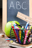 Chalkboard and colorful crayons Royalty Free Stock Images