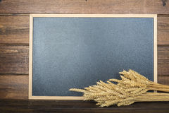 Chalkboard with a copy space and cereals Royalty Free Stock Photo