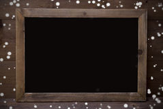 Chalkboard With Copy Space Wooden Background, Snowflakes Stock Photography