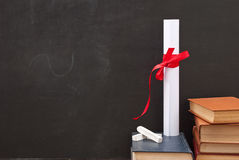 Chalkboard with a diploma Royalty Free Stock Image