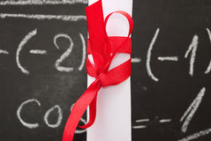 Chalkboard with a diploma Royalty Free Stock Photos