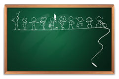 A chalkboard with a drawing of kids playing different sports Royalty Free Stock Photos