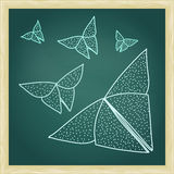 Chalkboard with drawing of origami butterflies in hairline outli Royalty Free Stock Photography