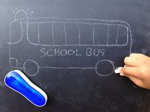 Chalkboard drawing of school bus. Stock Image