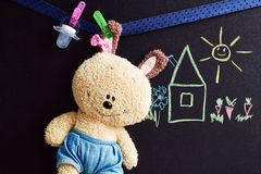 Chalkboard with drawing  and soft toy Royalty Free Stock Image