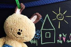 Chalkboard with drawing  and soft toy Royalty Free Stock Photos
