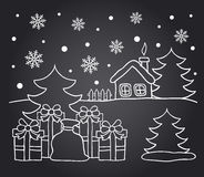 Chalkboard drawing of winter house and Christmas gifts Royalty Free Stock Photos