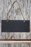 Chalkboard with dry branches on the old wood Stock Image
