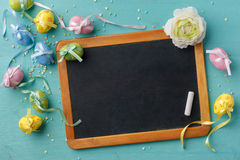 Chalkboard and easter decoration Royalty Free Stock Photos