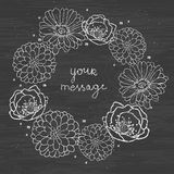 Chalkboard floral cirlce frame on blackboard Stock Image