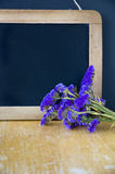 Chalkboard with flowers Royalty Free Stock Photography