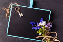 Chalkboard with flowers and key Royalty Free Stock Photos