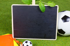 Chalkboard with ball and cards Royalty Free Stock Image