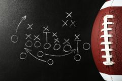 Chalkboard with football game scheme and rugby ball. Top view royalty free stock photos