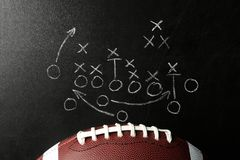 Chalkboard with football game scheme and rugby ball. Top view stock image
