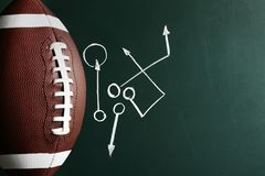 Chalkboard with football game scheme and rugby ball. Top view. Space for text stock photos