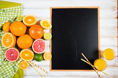 The chalkboard with fresh citrus.  Royalty Free Stock Image