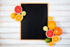 The chalkboard with fresh citrus.  Stock Images