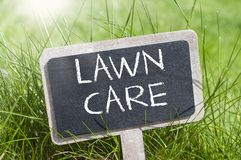 Chalkboard with garden equipment and lawn care stock images