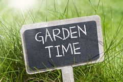 Chalkboard with garden time stock photography