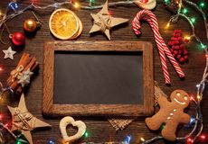 Chalkboard gingerbread Christmas tree and gifts on table top vi. Chalkboard gingerbread Christmas tree and gifts on wooden table top view Royalty Free Stock Photos