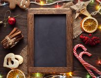 Chalkboard gingerbread Christmas tree and gifts on table top vi. Chalkboard gingerbread Christmas tree and gifts on wooden table top view Stock Image
